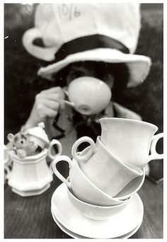 This is an image of the Mad Hatter sipping tea with other tea cups stacked in front. I like this photo as it appears authentic and real.  {I did not use this as a reference as I'm focusing on a different scene from Alice in Wondeland}