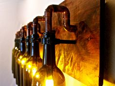 Wine Bottle Light Lamp - Industrial - Vanity - Sconce - Chandelier. $542.00, via Etsy.