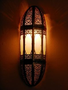 Moroccan lamps and lighting, sconce and its delicate openwork pattern.