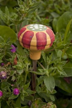 recycle.. painted doorknob becomes a garden stake or hose guide