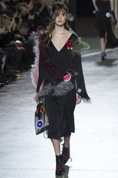 Marabou trimmings Christopher KaneContinuing the frilly, ruffly theme were all things feathered. At Christopher Kane, ostrich feathers burst from backless techno trainers, while marabou feathers in all hues fluttered from hips, shoulders and coat lapels. At McQueen they adorned the divine silk eiderdown coats that closed the show, and at Marques'Almeida they lined patent shoes.