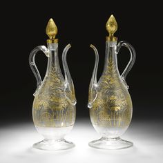 A Rare pair of Beykoz glass ewers of exceptional size, Turkey, early 19th century | lot | Sotheby's