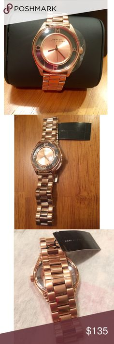 MARC by MARC JACOBS *NWT* rose gold watch Marc by Marc Jacobs rose gold watch. Works perfectly - NWT- clear plastic still on face. Face is rose gold with clear around it with MARC lettering inside . Box and user manual comes with. Marc by Marc Jacobs Accessories Watches