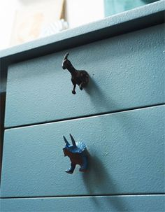 Dinosaur drawer pulls, on white dresser with gray drawers. paint inside of drawers to match main color of dinosaur OR paint all dinosaurs the same color and inside of drawers to match!