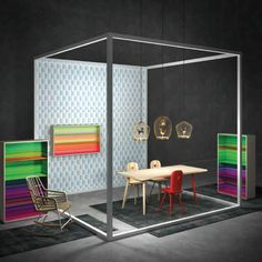 Libreria Color Fall da parete e da terra, stampa multicolor e struttura in legno di frassino. Scoprila in vendoarredo.com