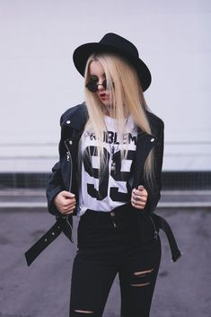 "Biker Jacket, Top ""99 Problems"", Black Ripped Knee Jeans, Set of Rings, 3 Set of Chokers & Round Glasses - http://ninjacosmico.com/29-grunge-outfit-ideas-fall/"