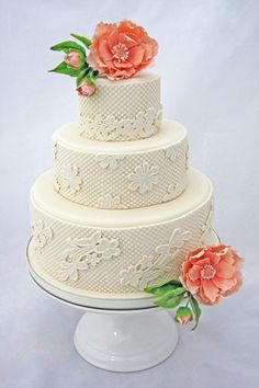 Patterned embossed fondant with cutout flowers, peach color