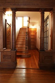 Hallway with columns and staircase with a carved newel post in a Victorian (1890) house - 272 Albany Ave, Kingston, NY