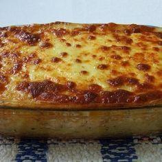 Receita de Frango Diferente Gratinado - 1 colher (sopa) rasa de farinha de trigo, 1/2 tablete de caldo de galinha, 1 xícara (chá) de leite, 2 caixinhas de c...