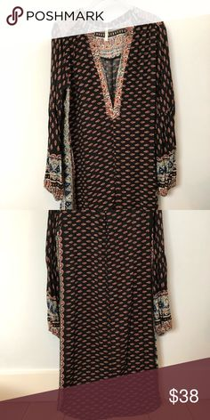 Dress/beach cover up by Raga This printed rayon high/low dress hits mid knee in front, midi length in back. Features a very deep vee and balloon sleeves in a black background Indian print. Loose and flowing. New , never worn, no tags. RAGA Dresses High Low