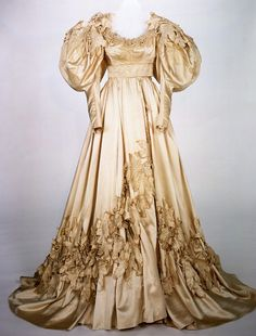 "Scarlett O'Hara silk satin wedding dress designed by Walter Plunkett for the movie ""Gone With the Wind."" Plunkett created more than 5,000 separate items of clothing for more than fifty major characters for GWTW."