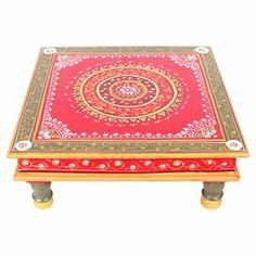 """Artfully handcrafted, this distinctive wood coffee table showcases a vibrant medallion motif for a touch of wayfaring appeal.     Product: Coffee tableConstruction Material: WoodColor: MultiFeatures:  HandcraftedMedallion motif Dimensions: 6"""" H x 15"""" W x 15"""" D"""