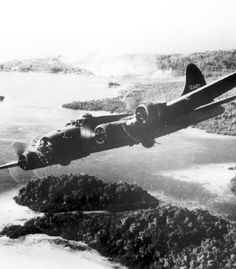 Flying Fortress B-17 on a sortie over a Japanese installations on Gizo Island in October, 1942. This one raid was part of a series of air attacks on the enemy during the fight for Guadalcanal, you can see the smoke from the bomb strikes in the background.