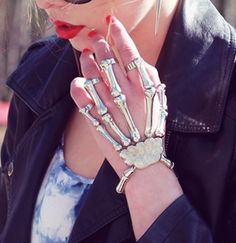 Skeleton Ring Bracelet. whaaaaaaat? I can't decide whether i think its completely strange, or I absolutely love it...maybe a little of both.