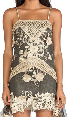 This would be a pretty tunic with skinny jeans or a slim skirt.