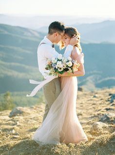 Scenic mountain top elopement inspiration: http://www.stylemepretty.com/little-black-book-blog/2015/11/17/pastel-mountain-elopement-inspiration/ | Photography: Alexandra Grace - http://www.alexgracephotography.com/