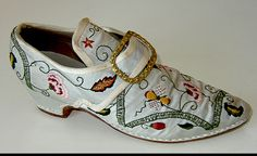 I'm not even sure where to file this--Garb, Needlework, or Shoe Love! Hand-embroidered Baroque shoes by master costumer Ninya Mikhaila. Swoon!