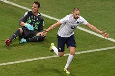 France's forward Karim Benzema celebrates after scoring during a Group E football match between Switzerland and France at the Fonte Nova Arena in Salvador during the 2014 FIFA World Cup on June 20, 2014.