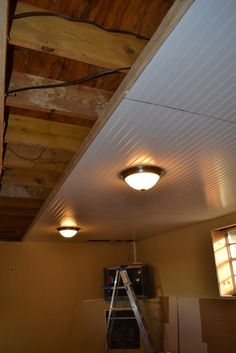 Basement Ceiling Installation - no more cobwebs in my hair!!