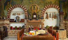 The authentic wall paintings with Byzantine scenes, smoked fish hung to dry in niches, the abundance of refined tastes, will attract you in the world of the. Smoked Fish, Byzantine, Wine Cellar, Provence, Table Settings, Interior, Kitchens, Design, House