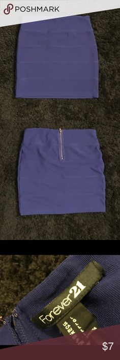 Large Blue Forever 21 Pencil Mini Skirt This Forever 21 pencil skirt is a size large but fits like a medium. Has a zipper in the back. A really pretty Blue Great condition! No tears or stains! Forever 21 Skirts Mini