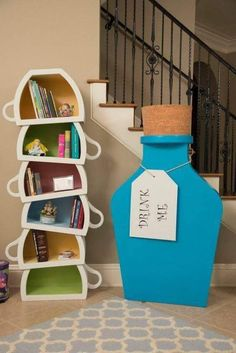 This teacup bookshelf and larger-than-life Drink Me statue are straight out of Wonderland. Ashley Eckstein Alice in Wonderland Dining Room Tour Disney Themed Rooms, Disney Bedrooms, Casa Disney, Disney Diy, Alice Disney, Alice In Wonderland Room, Wonderland Party, Deco Disney, Disney Home Decor