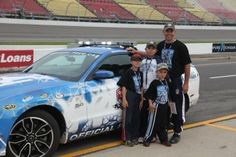 Master Sergeant Daniel Bauer and his family participated in a pace car ride at the Michigan International Speedway at the 2013 Quicken Loans 400. Bauer was joined by fellow soldiers as part of NASCAR: An American Salute and the Troops to the Track program, a partnership with the Armed Forces Foundation. Credit: Eric Dobb