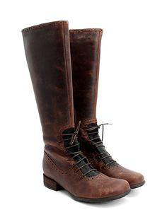 Beautiful brogued boots in equestrian style.  Even better, they are lace- adjustable at the vamp!