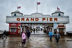 Weston-super-Mare, England  United Jack flags fly in the wind as people walk around the Grand Pier. Rain and wind battered Britain's western coastline in the week in which Britain's referendum result left the public and political leaders reeling. Click here to view the picture essay Brexit and beyond: seven days that shook the UK Photograph: Ben Birchall/PA