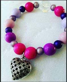 Check out this item in my Etsy shop https://www.etsy.com/listing/263822964/sale-girls-heart-charm-bracelet