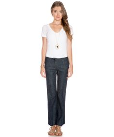 Yves Saint Laurent's ankle•skimmers are designed to become every woman's go•to pair. Crafted in Italy, these jeans include front welt pockets, two back patch pockets, subtle pleated detailing at front, belt loops, and black enamel branded button and zipper closure