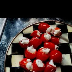 Easy appetizer: Buy peppadews from the olive bar at Wegmans, and herbed goat cheese. Pipe it in with a Baggie snipped at the corner.