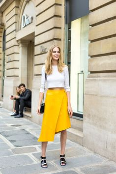 131 chic outfit ideas to copy from the street style scene at last week's Paris Couture Week: a bright yellow midi skirt pops against a classic white shirt