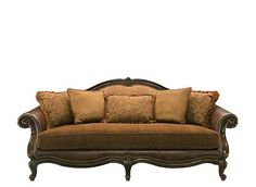 A charming testament to French design, this Natalia leather and chenille sofa in bronze will adorn your living room with its opulence and richness. Its quality leather and chenille upholstery lend an elegant 2-toned look, while a carved wood trim with an intricate acanthus leaf carving, nailhead accents, rolled arms and curvy cabriole legs completes the sofa's breathtaking appeal.