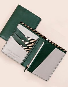 matter matters passeport wallet •Natural forest Green, grey and black cow skin leather, striped metallic PVC •Canvas Lining  •Seven card slots, three big slots for passport, one receipt slots  •Zipper pocket for coins  H: 14.2cm W:10.5cm D:2cm