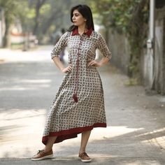 Buy Rustorange Grey & Maroon Dabu Hand Block Printed Asymmetric Kurti online in India at best price. For a beautiful look that doesn t burn a hole in your pocket, this kurta dress will surely capture e Printed Kurti Designs, Kurta Designs, Kurti Patterns, Dress Patterns, India Fashion, Ethnic Fashion, Shirt Style Kurti, Latest Kurti, Kurti Collection
