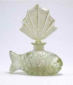1930s Czech figural perfume bottle, as a fish, lemon yellow crystal, intaglio stopper, dauber.