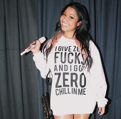 Nicki Minaj wearing a hoodie with lyrics from Side to Side