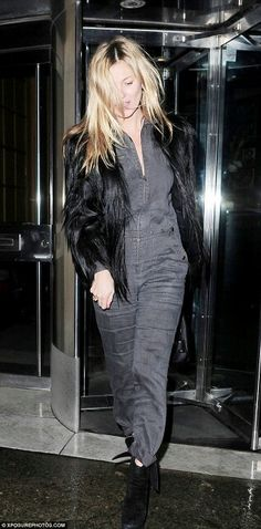 Kate out in London wearing a chic grey jumpsuit