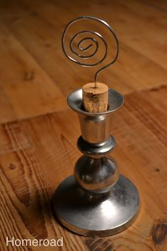 Cute idea to repurpose a candle holder and wine cork. Maybe paint candlestick. Place several in display vignette with vintage postcards or photos. Picture Holders, Photo Holders, Wine Cork Crafts, Bottle Crafts, Fun Crafts, Arts And Crafts, Lavender Sachets, Glass Candlesticks, Decoupage