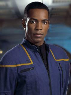 "Anthony Montgomery as Ensign Travis in ""Star Trek: Enterprise"" (TV show) http://www.imdb.com/name/nm0599719/"