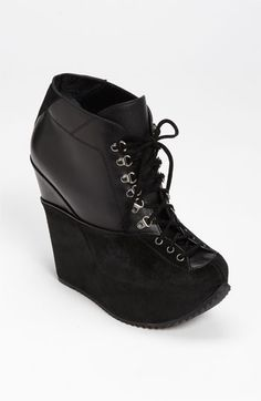 Yves Saint Laurent 'Ski' Ankle Boot available at Nordstrom... A really ugly shoe for only $1,254.00.