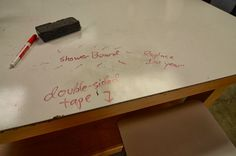 Showerboard is a less expensive alternative to whiteboard... but less durable.  http://wiki.xtronics.com/index.php/Shower_Board_as_a_white_Board