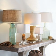Horchow - miscellaneous, neutral and glass table lamps on a console table