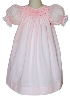 Delicate girls Brooklyn pink dress made by CarouselWear. It is finely made in 100% peruvian cotton and hand smocked around the collar, the skirt is adorned with 3 pin-tucks. Absolutely divine. Bonnet