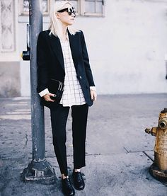 An untucked grid-line button down with a blazer and trousers is tomboy-chic.