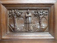 Early 17th century English antique oak carved panel depicting a figure with book