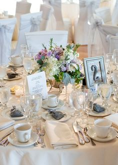Simply lovely all white with pastel flowers table setting. Wedding Reception Centerpieces, Wedding Decorations, Table Decorations, Place Settings, Table Settings, Private Wedding, Banquet Tables, Event Company, Pastel Flowers