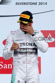 - #LewisHamilton of #GreatBritain and #MercedesGP wipes his eyes as he celebrates on the podium after winning the #BritishFormulaOneGrandPrix at Silverstone Circuit on July 6, 2014 in Northampton, United Kingdom.