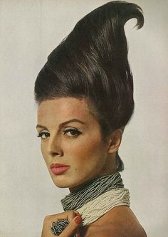 Tilly Tizzani, March Vogue 1963 By Bert Stern Wearing 'Charles of the Ritz' make-up and pounds of fake seed pearls by Trifari. Bert Stern